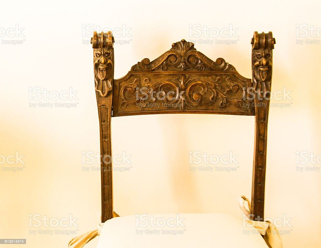 Antique Baroque Carved Chair, Pale Yellow Background stock photo