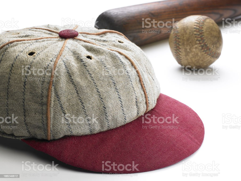 Antique baseball cap, bat and ball on white background royalty-free stock photo