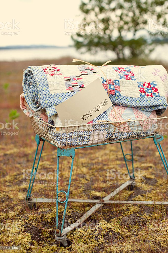 Antique Basket with Blankets and Sign stock photo