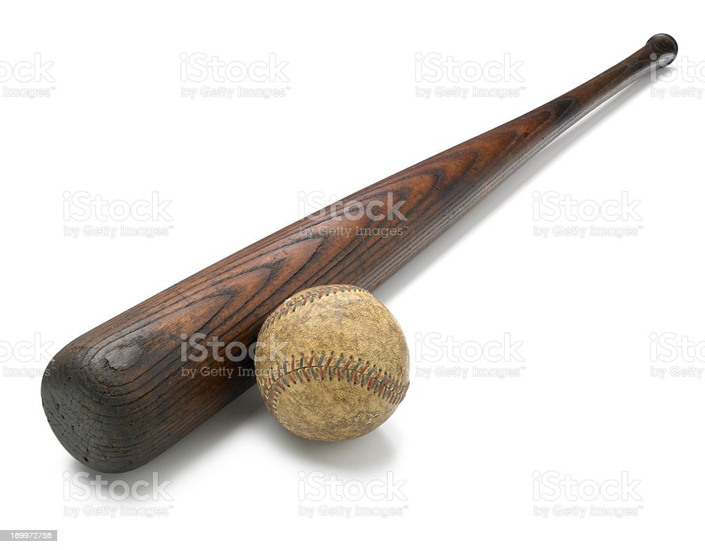 Antique bat and baseball isolated on white background stock photo