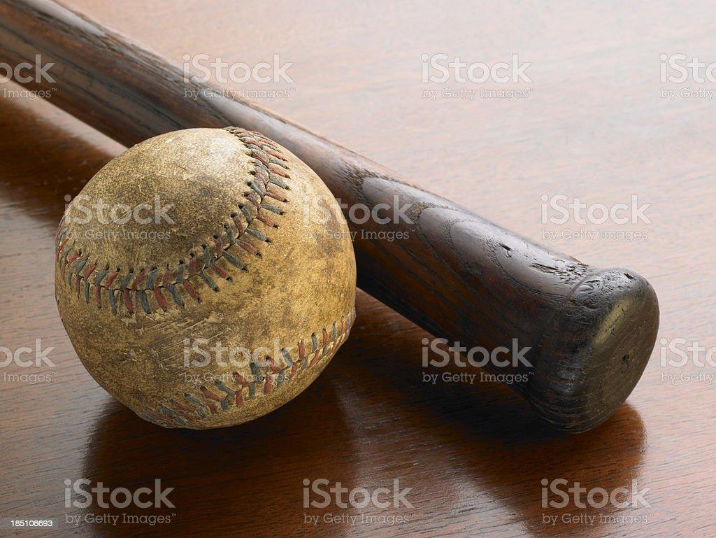 Antique bat and baseball on wood background royalty-free stock photo
