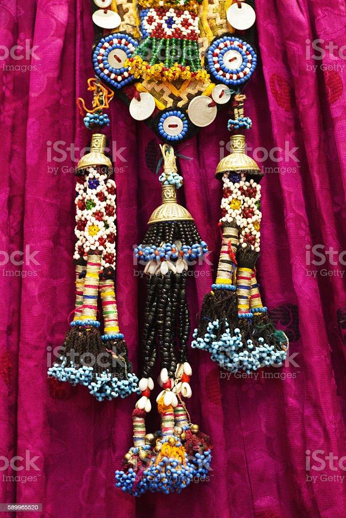 Antique Beaded Pakistani Necklace on Purple Dress (Close-Up) stock photo