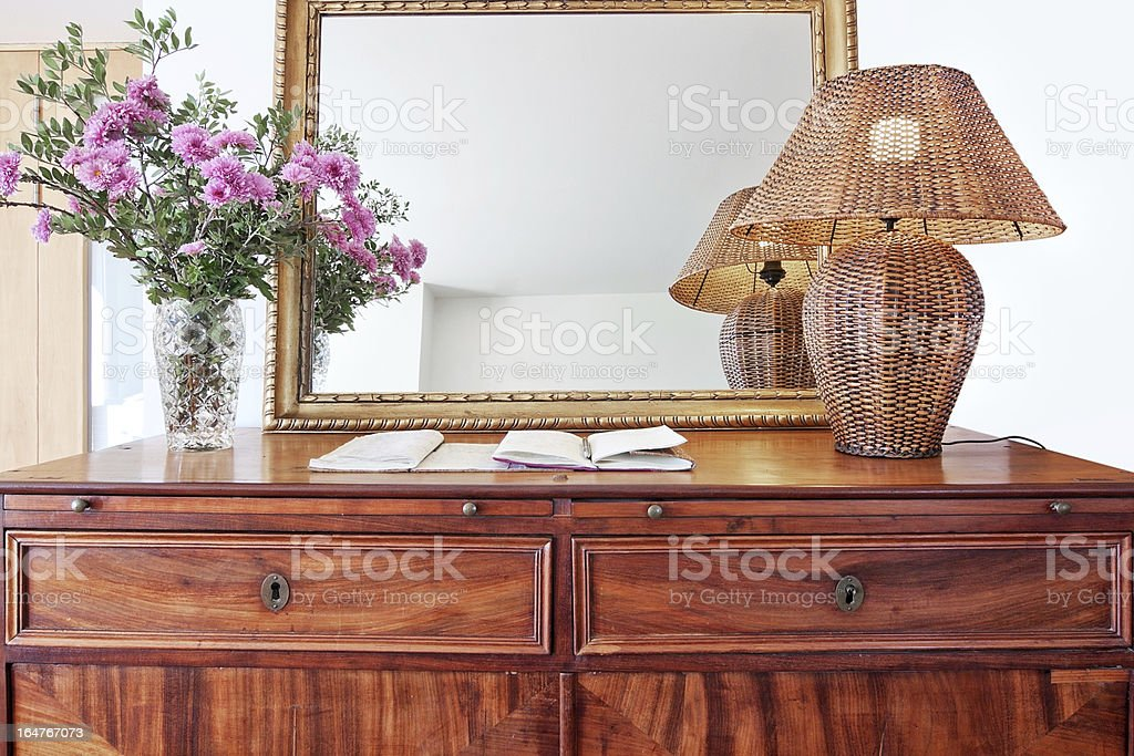 Antique bedside table and luminous shade. royalty-free stock photo