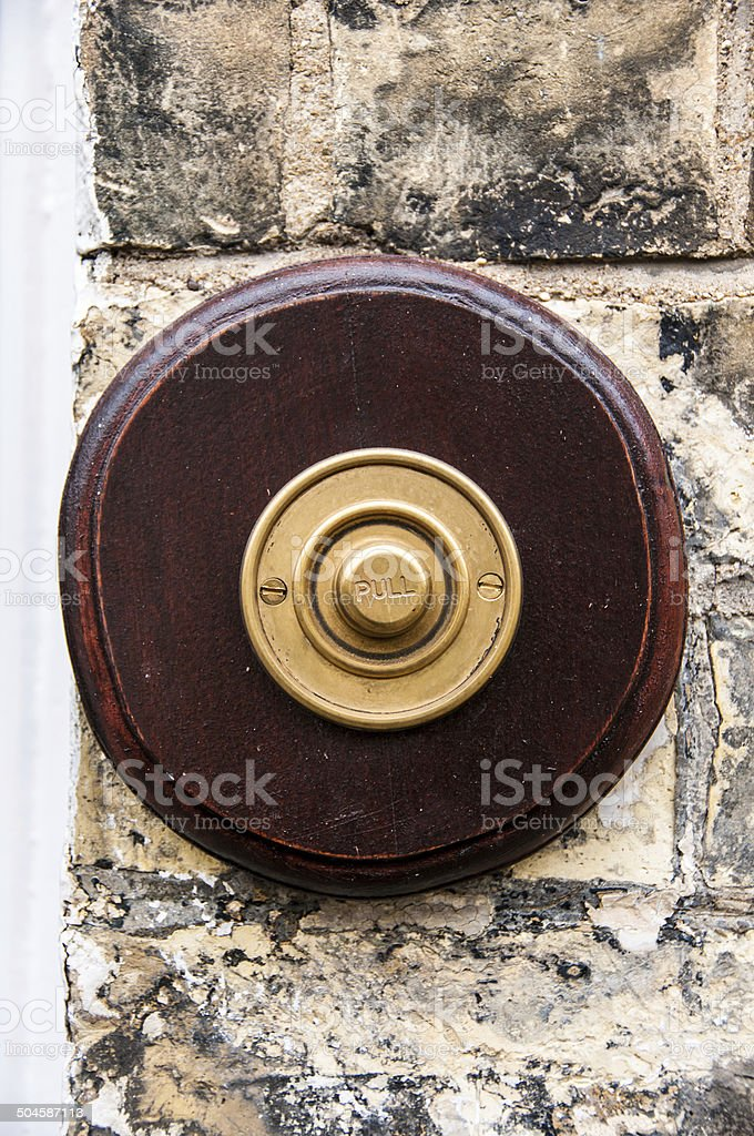 Antique bell pull on a door Cambridge, UK stock photo
