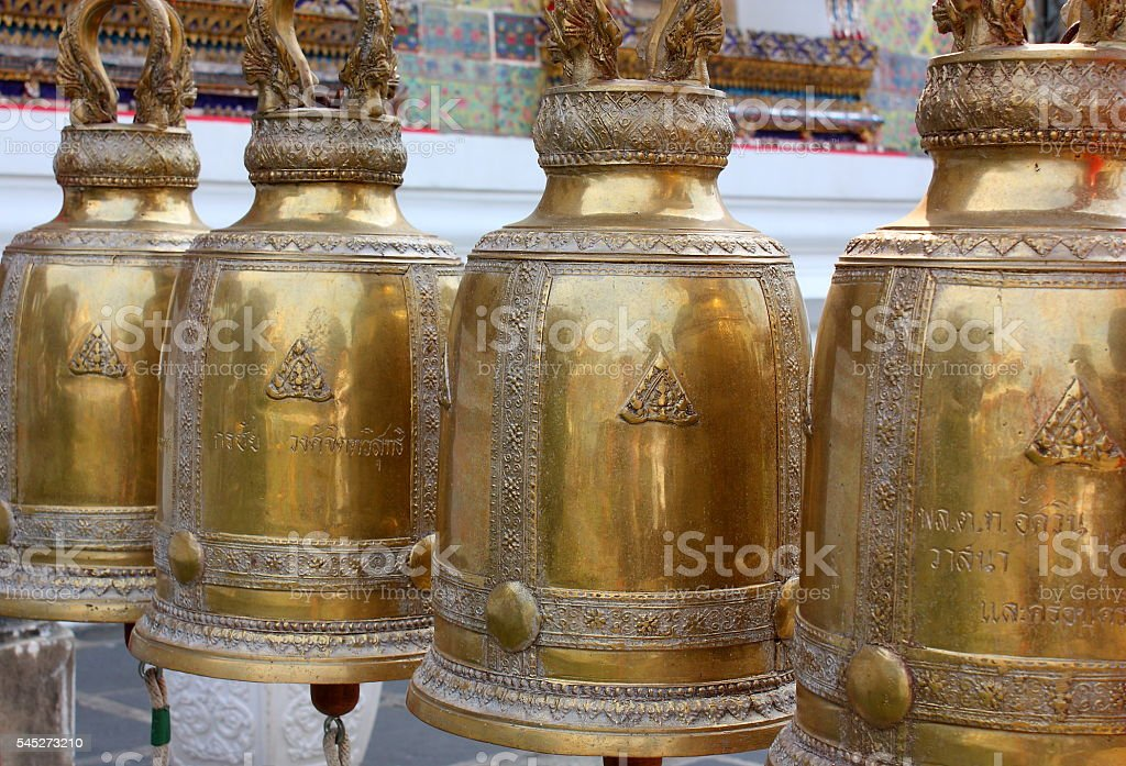 Antique bells in a buddhist temple of Thailand stock photo