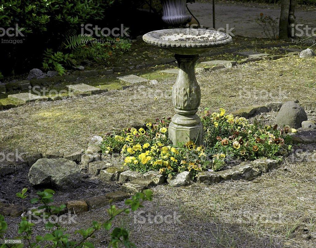 antique bird bath in Charleston garden royalty-free stock photo