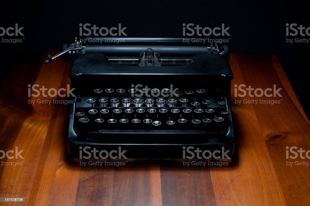 Antique Black Typewriter on a Wooden Desk royalty-free stock photo