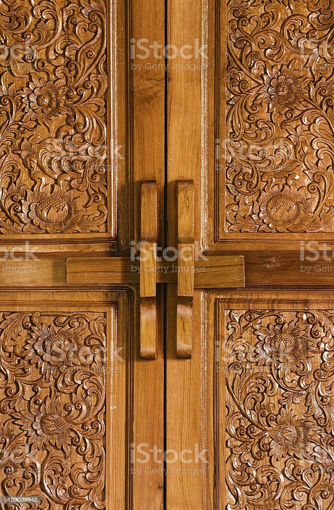 Antique bolt on wooden flowered door stock photo