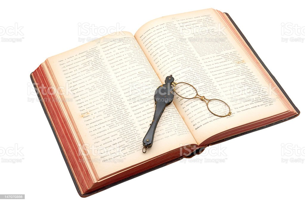 Antique book with lorgnette royalty-free stock photo