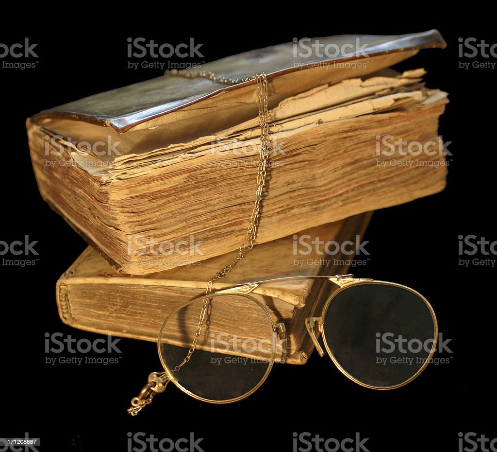 Antique books and glasses on black royalty-free stock photo
