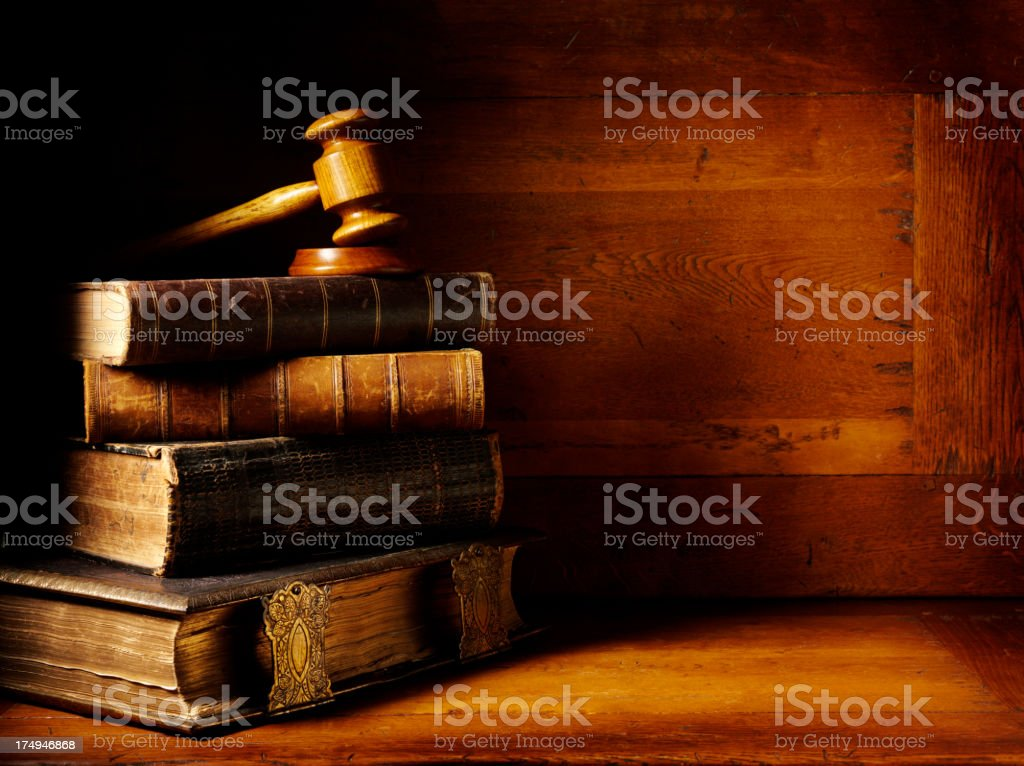 Antique Books and Wooden Gavel with a Mallet stock photo