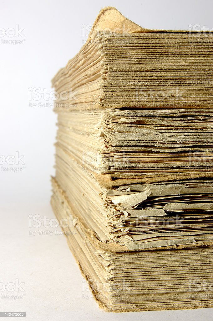 Antique books piled front a silver background royalty-free stock photo