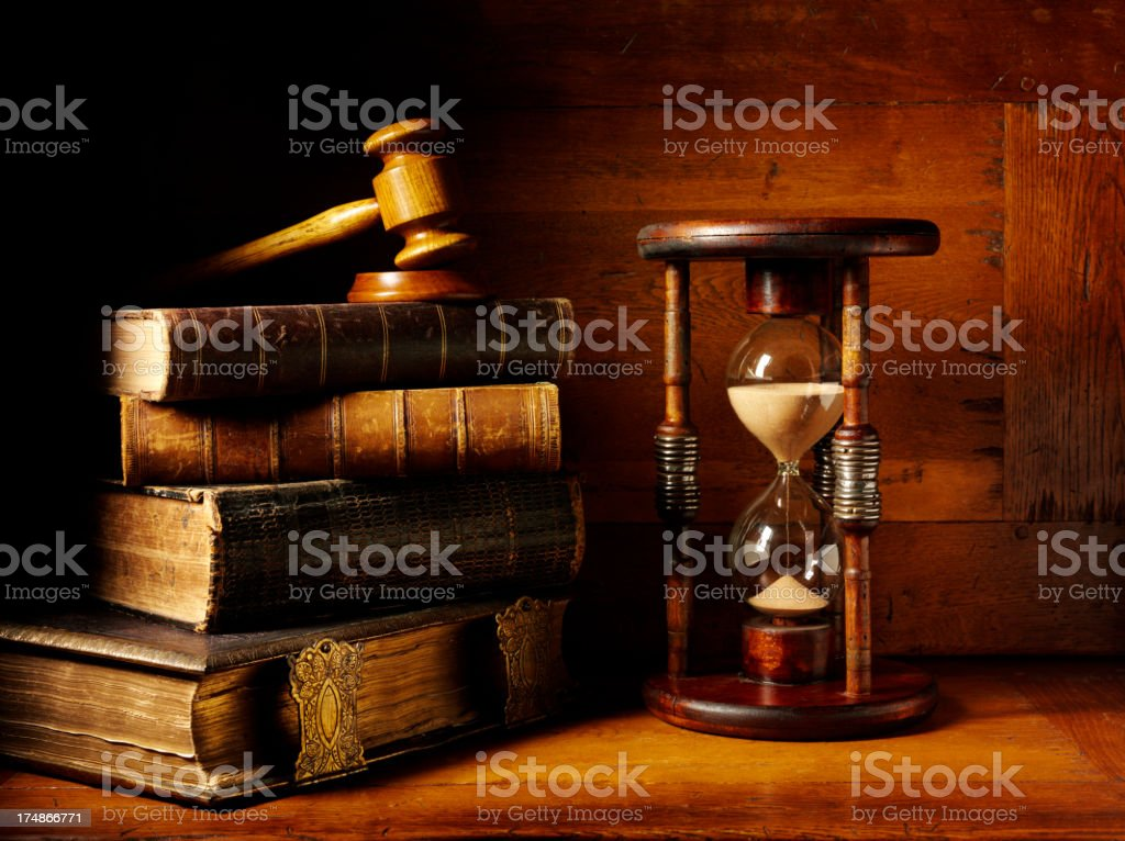 Antique Books with a Magnifyng Glass and Hourglass stock photo