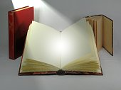 Antique books with directional light. Divine presence concept.