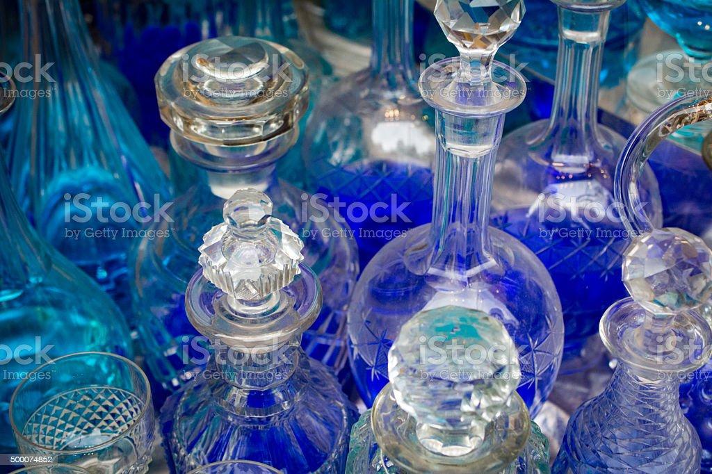 antique bottles with blue liquid stock photo