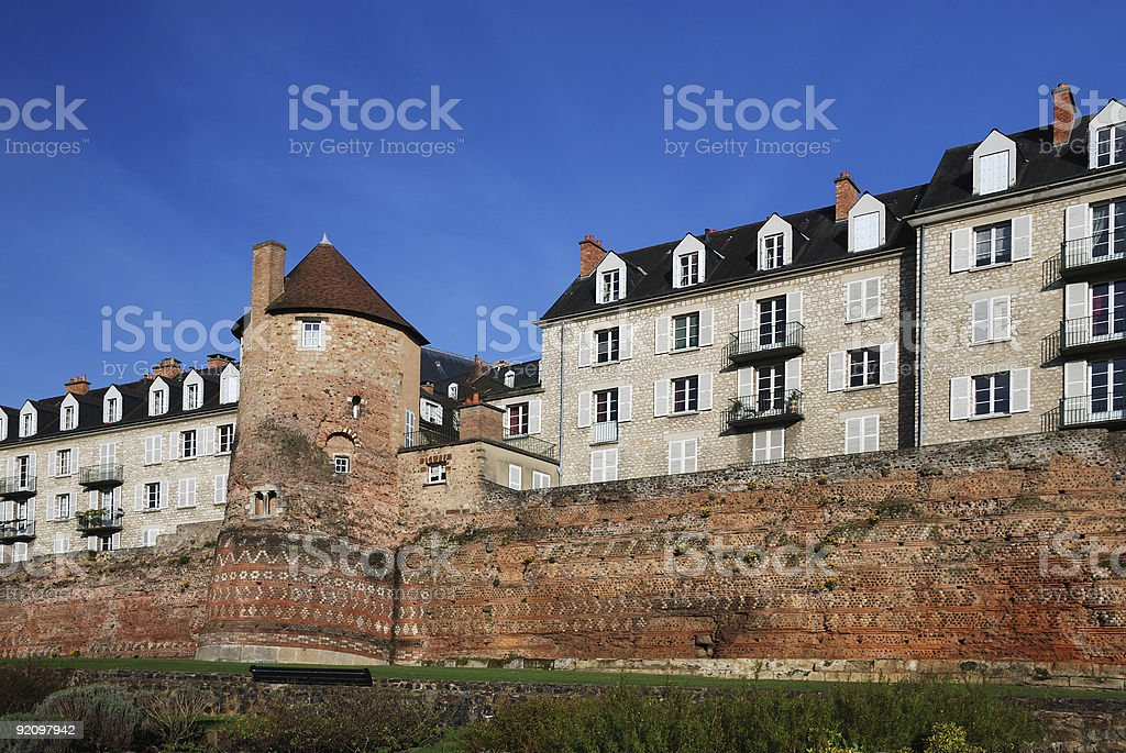 Antique boundary wall renewed and modern houses, Le Mans stock photo
