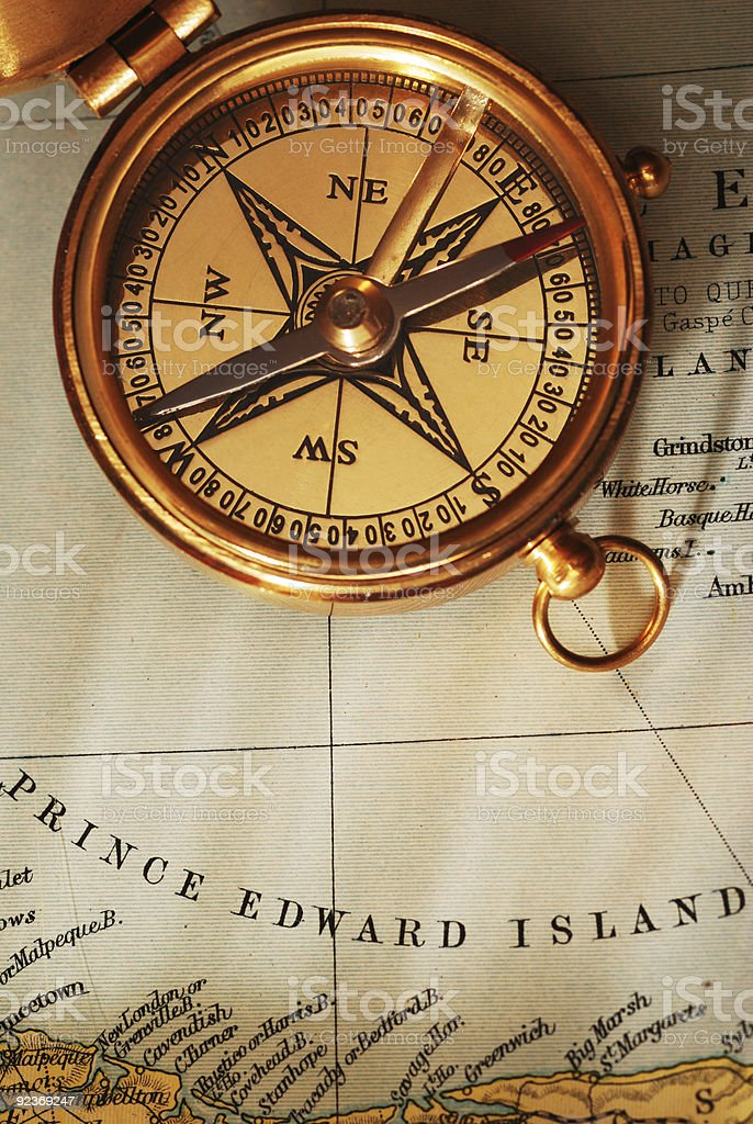 Antique brass compass over old Canadian map royalty-free stock photo