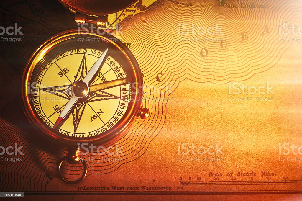 Antique brass compass over old USA map stock photo
