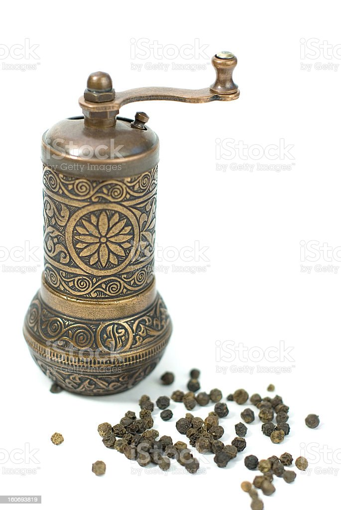 antique brass pepper mill with peppers royalty-free stock photo