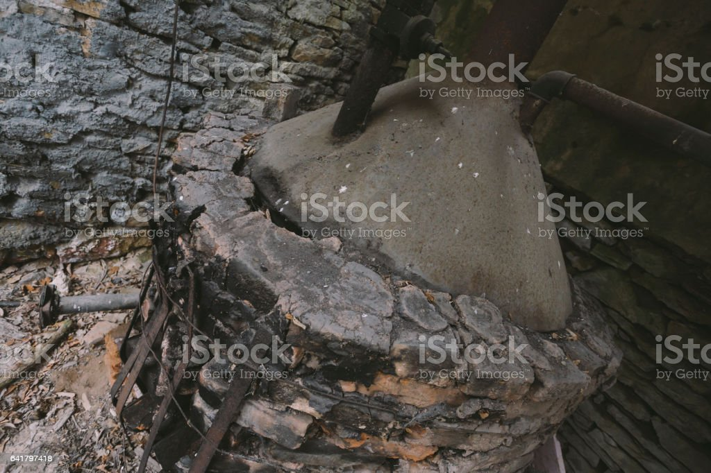 Antique brick water furnace boiler in old spa stock photo