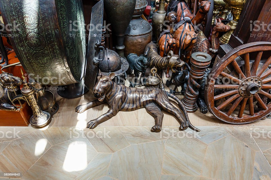 Antique Bronze Tiger Sculpture with Many Antiques stock photo