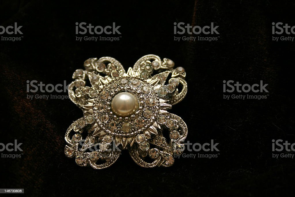 Antique brooch on brown velvet royalty-free stock photo
