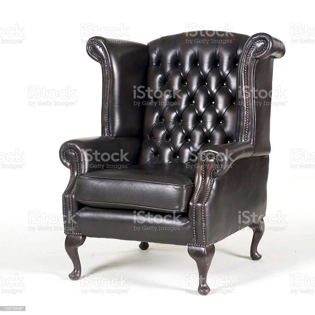 Antique brown leather armchair stock photo