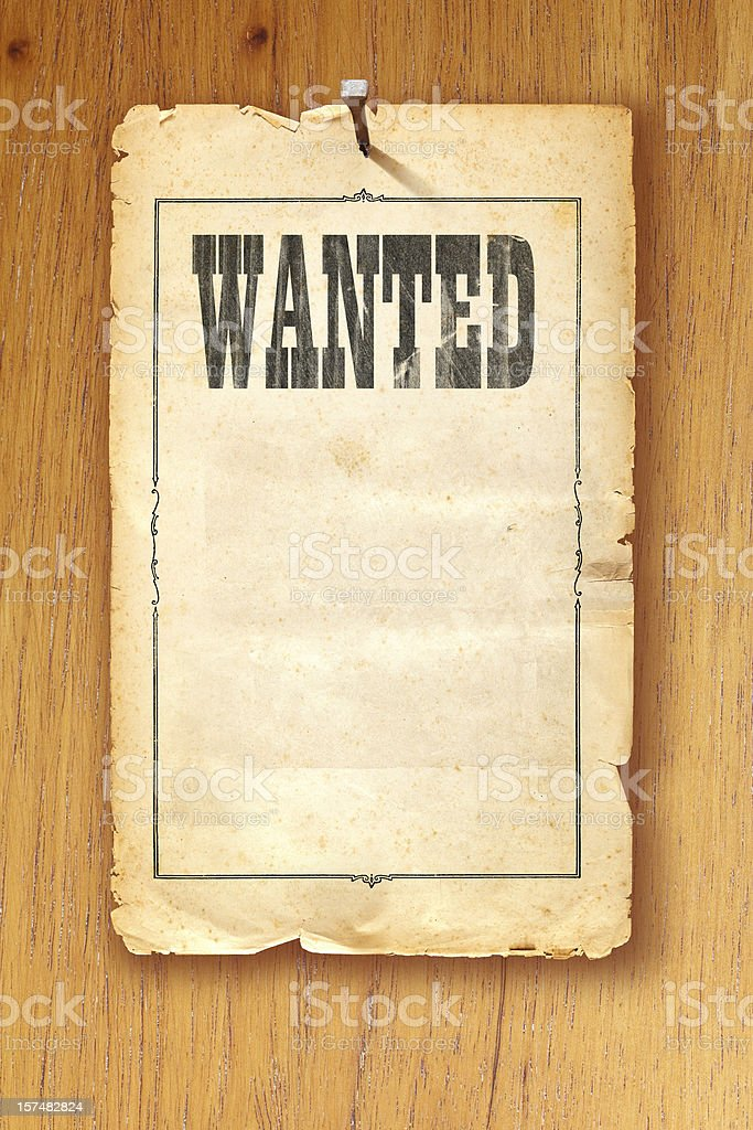 Antique brown wanted poster fixed with nail on wooden background stock photo