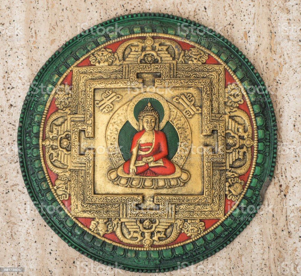 antique buddha plate stock photo