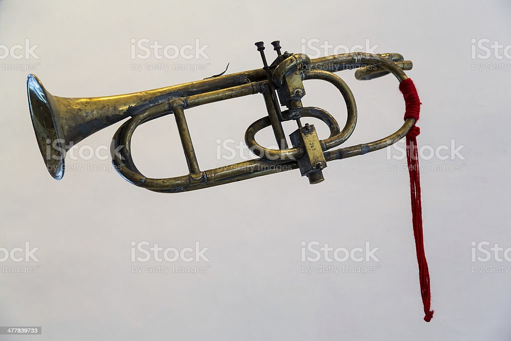 Antique bugle or trumpet isolated against grey royalty-free stock photo