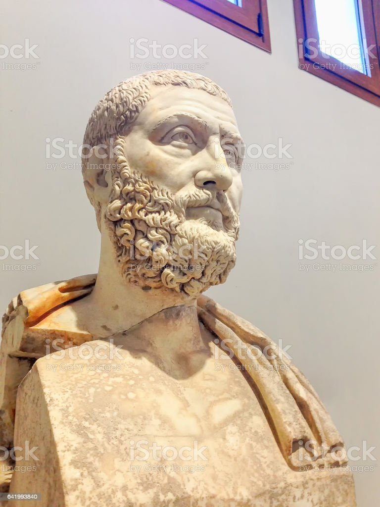Antique bust of Greek man stock photo