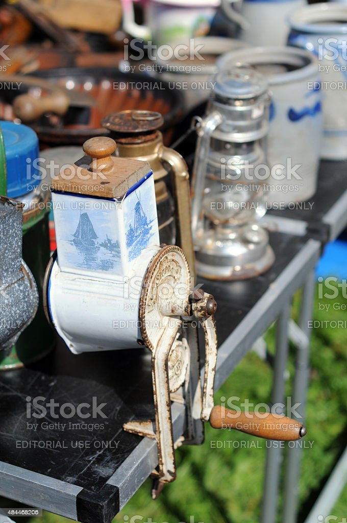 antique cafe mill and glass lamp on flea market stock photo