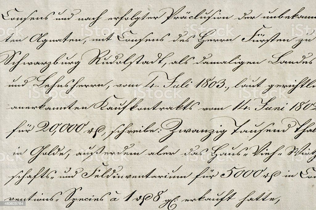 Antique calligraphic handwriting. Old ink manuscript. Paper background stock photo