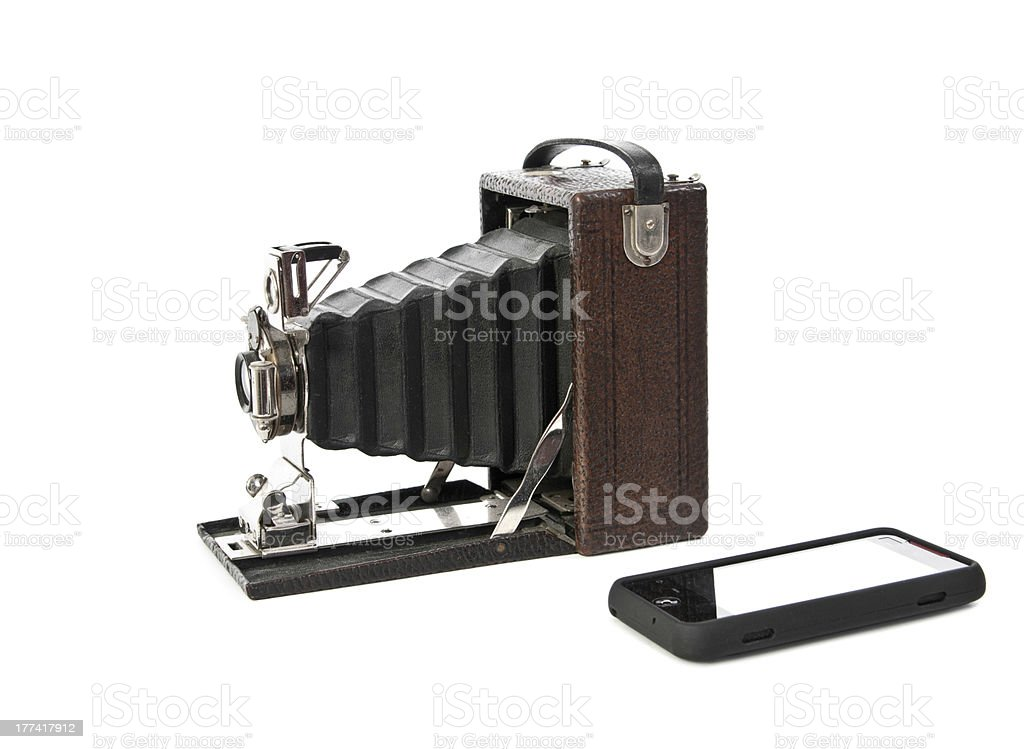 Antique camera and cell phone royalty-free stock photo