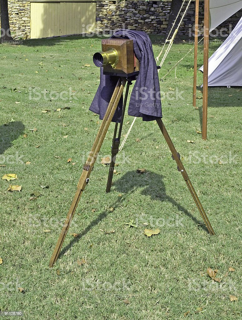 antique camera and tripod royalty-free stock photo