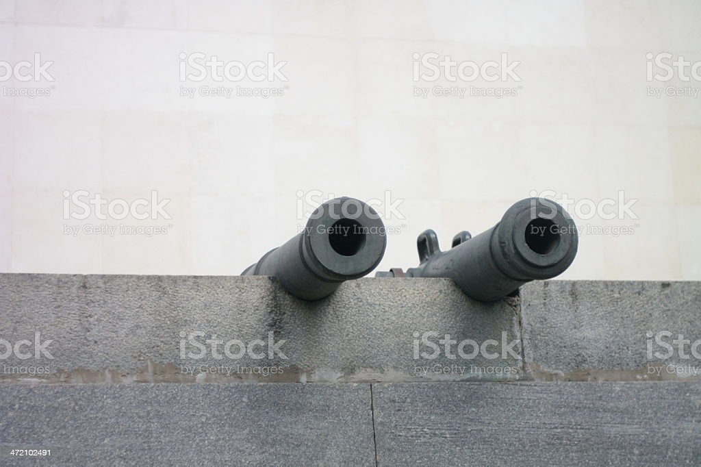 antique cannon on wall stock photo