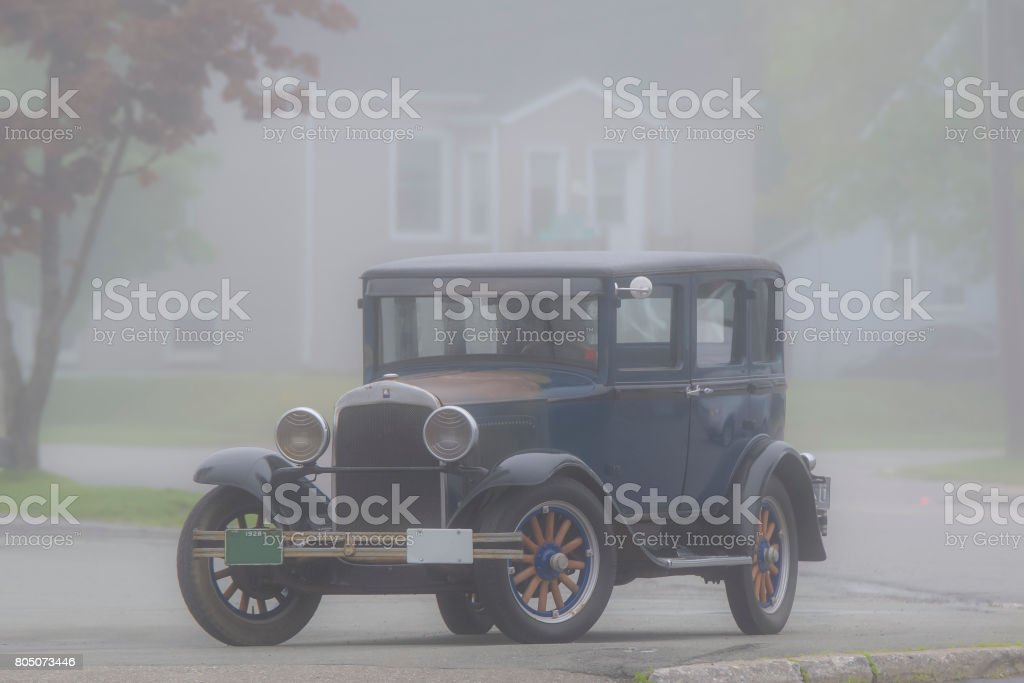 Antique Car In Fog stock photo