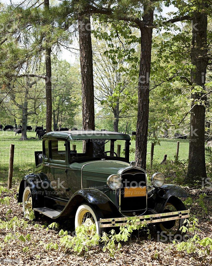 Antique car in rural scene. stock photo