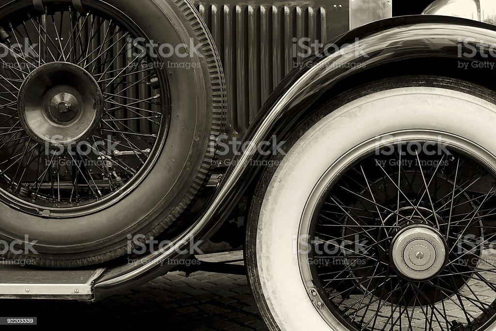 Antique car wheels sepia stock photo