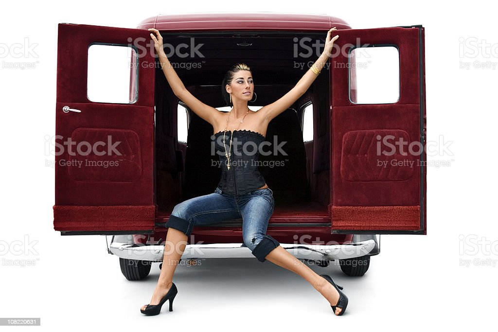 Antique Car with Beautiful Sexy Young Woman in High Heels royalty-free stock photo