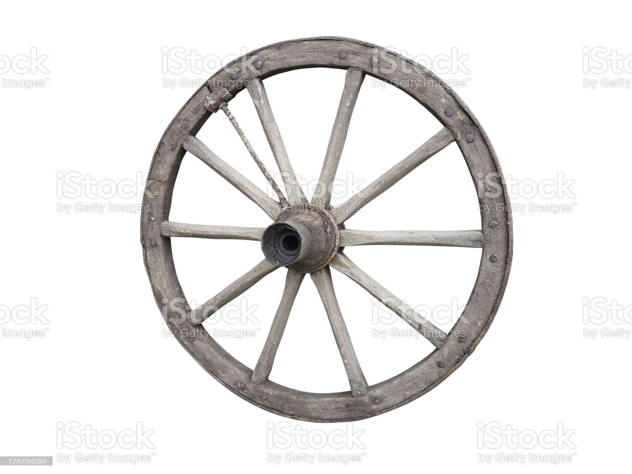 Antique Cart Wheel made of wood and iron-lined, isolated royalty-free stock photo