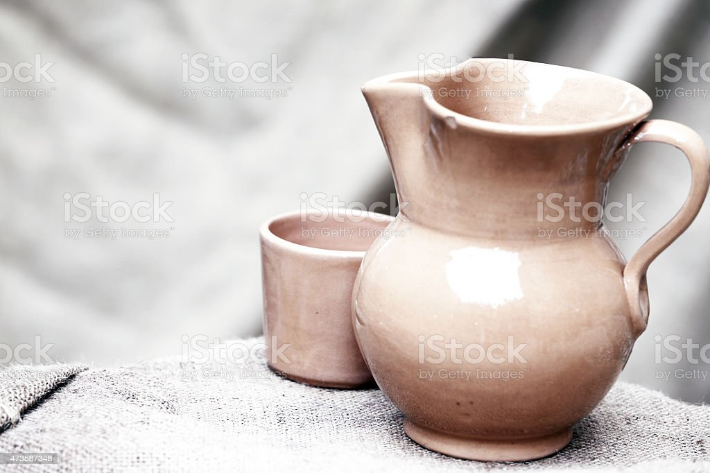 antique ceramic jug with medieval-style glass stock photo