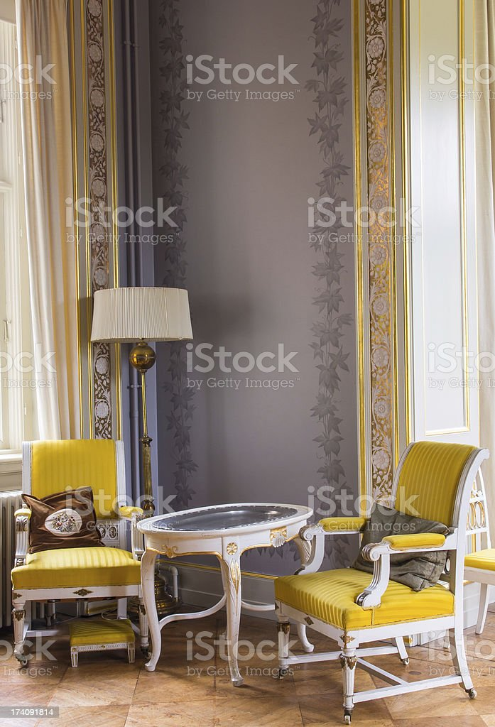 Antique chairs and table stock photo