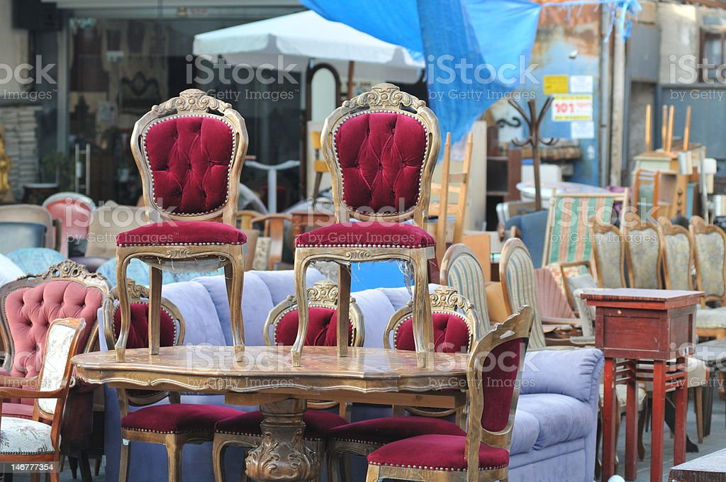Antique Chairs on a table at flea market royalty-free stock photo