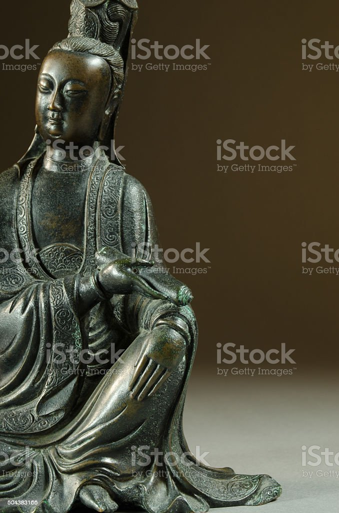 Antique Chinese Bronze Guanyin Sculpture stock photo