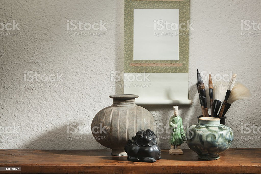 Antique Chinese Potteries Display with Blank Scroll Painting Advertising Sign stock photo