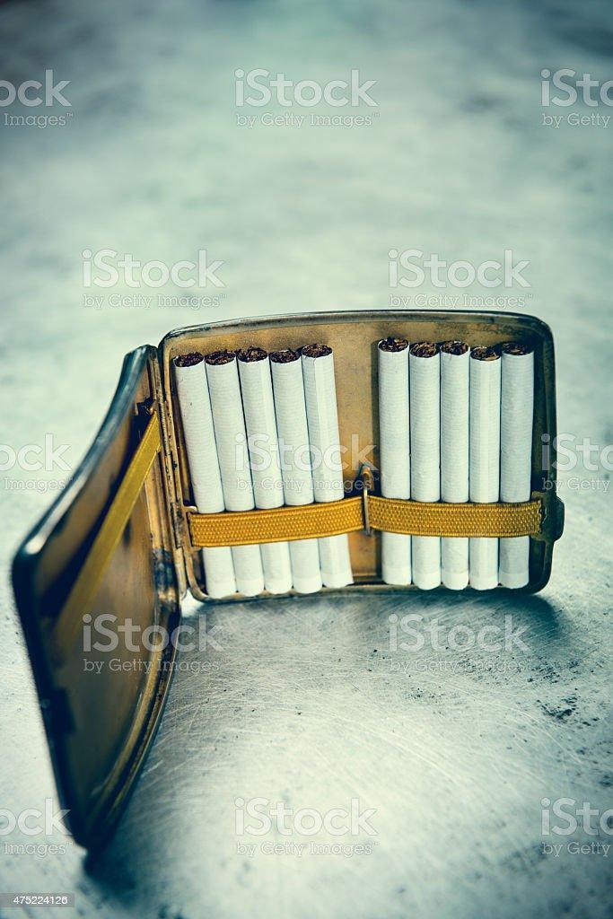 Antique Cigarette Case Complete With Cigarettes stock photo