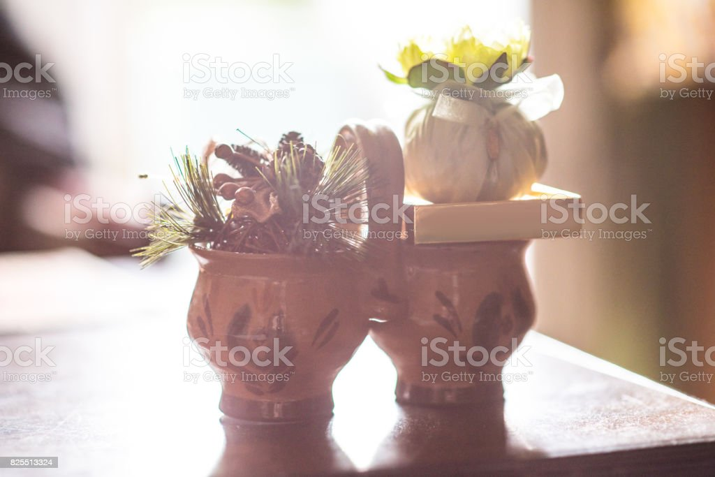 Antique Clay dishes with sashet on room background stock photo
