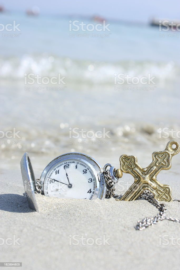 Antique clock and a cross royalty-free stock photo