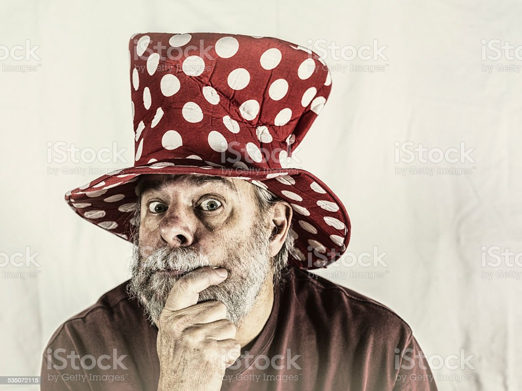 Antique Clown Hat Quizzical Senior Man stock photo